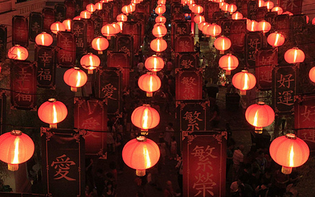 People walk under a Chinese Lantern display during a Chinese New Year eve celebration at Chinatown in Manila February 18, 2015. The Chinese Lunar New Year on February 19 will welcome the Year of the Sheep (also known as the Year of the Goat or Ram).   REUTERS/Romeo Ranoco (PHILIPPINES - Tags: SOCIETY RELIGION)